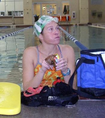 Stuffing my face in my green swim cap last year